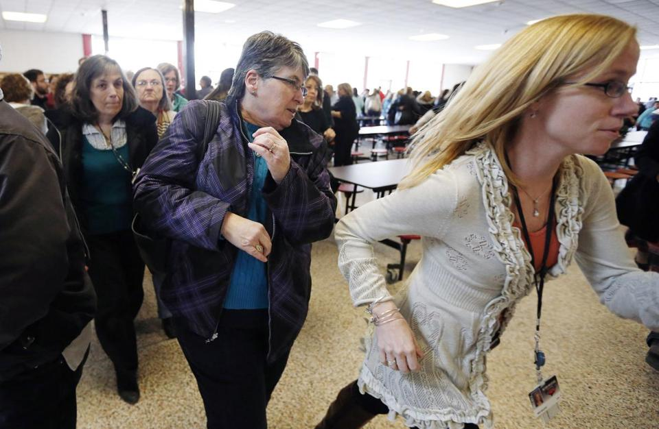 Students and teachers in the Milford High cafeteria scattered during a safety drill Friday.