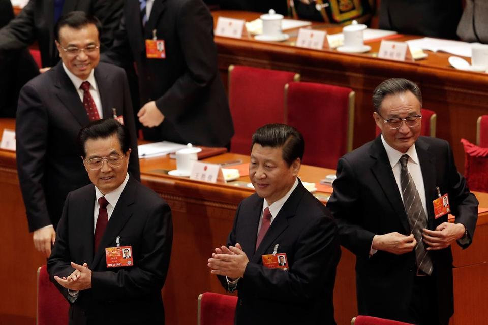 Xi Jinping (front right) followed Hu Jintao (front left) and took the helm as China's president during a meeting of the National People's Congress in Beijing on Thursday.
