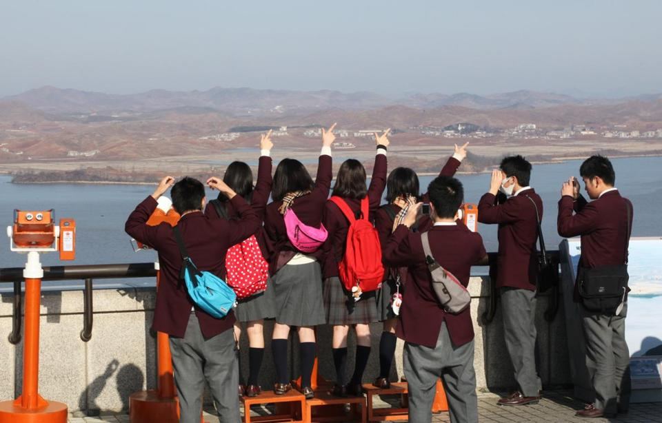 High school students from Japan gestured toward North Korea on Thursday near the demilitarized zone in South Korea.