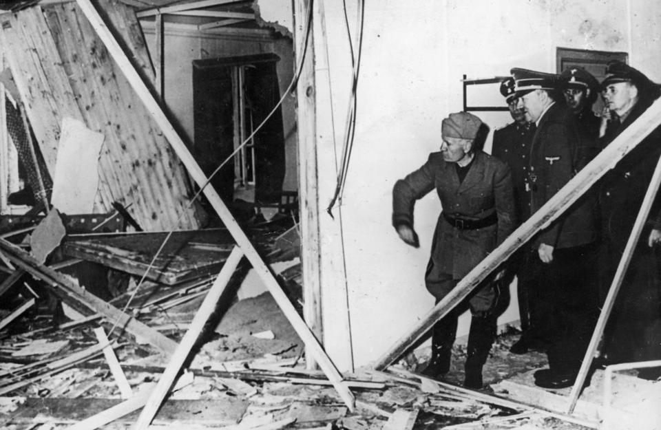 Benito Mussolini and Adolf Hitler inspected damage after the assassination attempt.