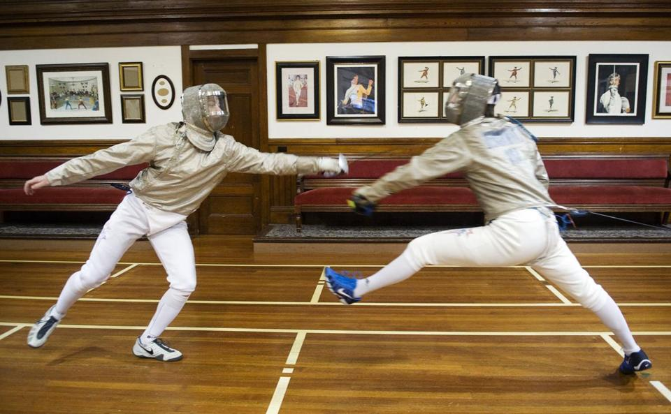 Westwood's Andrew Mackiewicz (left ) and Sherborn's Eli Dershwitz practiced at the Zeta Fencing Club Thursday, March 14, 2013.