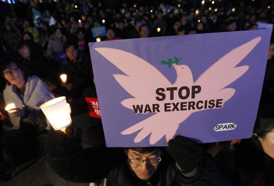 Protestors in Seoul denounced the joint US-South Korea military exercises on Saturday. US officials hope moving missiles to Alaska may offer protection from a North Korean strike.