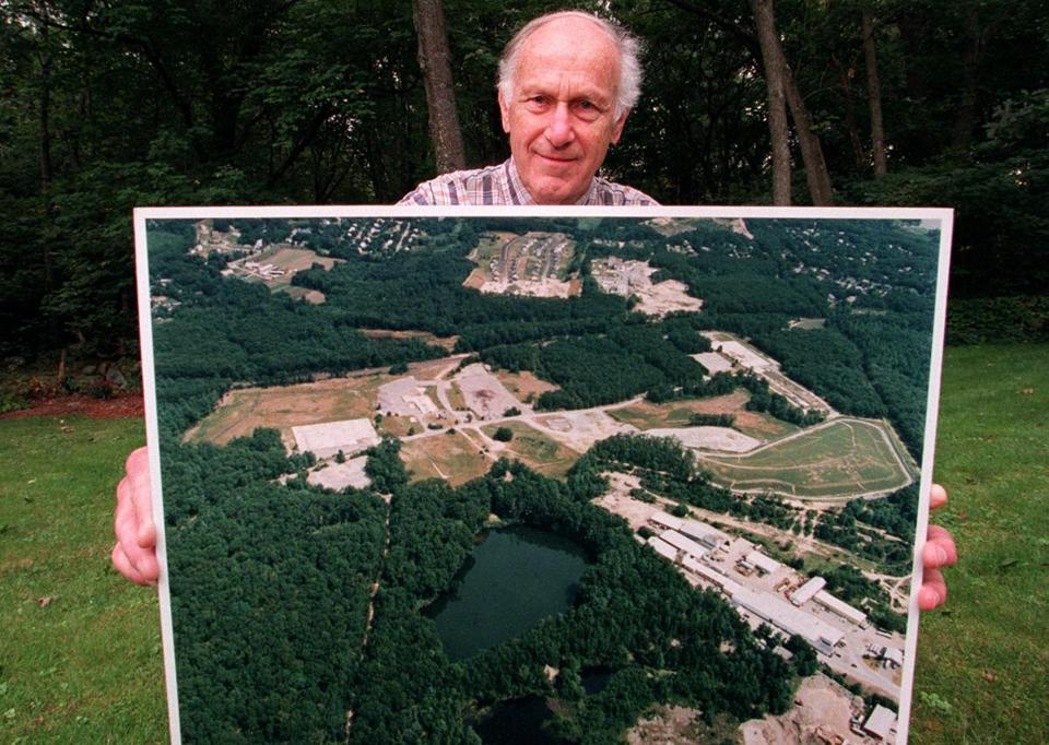 Mr. Eisengrein held an aerial photo of the contaminated Acton Superfund site in 2000.