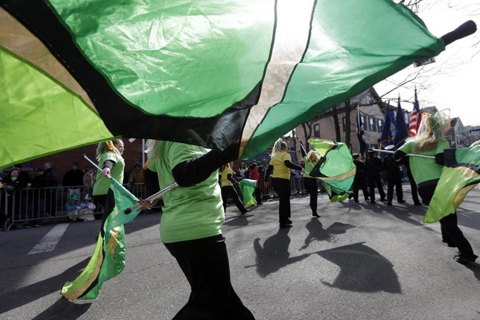 Members of the Sanford High School color guard of Sanford, Me., twirled flags while marching in last year's St. Patrick's Day Parade.   (AP File Photo/Steven Senne)
