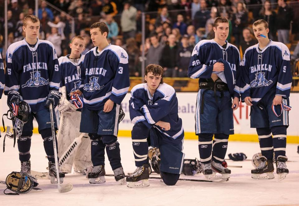 Members of the Franklin High boys' hockey team ponder their loss Sunday in the state finals — for the third straight year.
