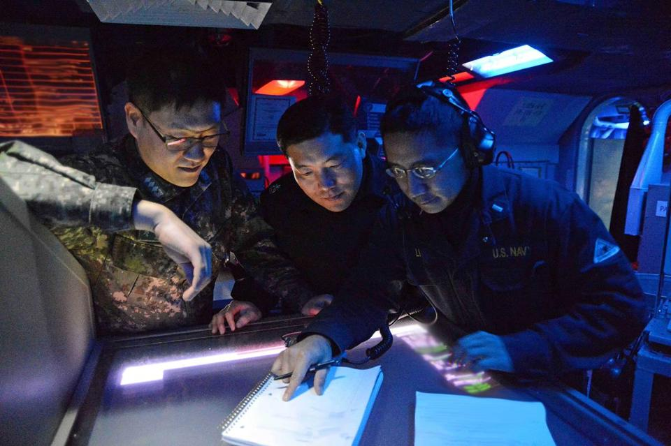 US and South Korean naval officers worked together in the combat operations center of the guided-missile destroyer USS John S. McCain during exercises Monday.