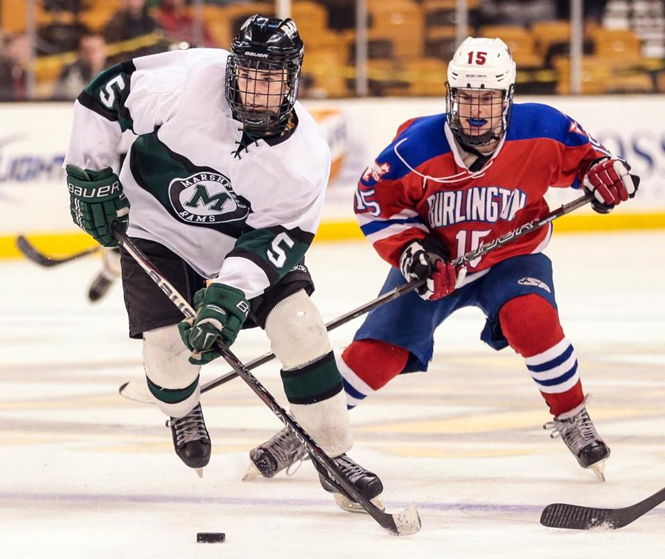 Marshfield's Jimmy Connors (left) skates past a Burlington player in Sunday's Division 1 championship game at the TD Garden in Boston. Burlington won, 4-2, ending the Rams' stellar 20-7 campaign.