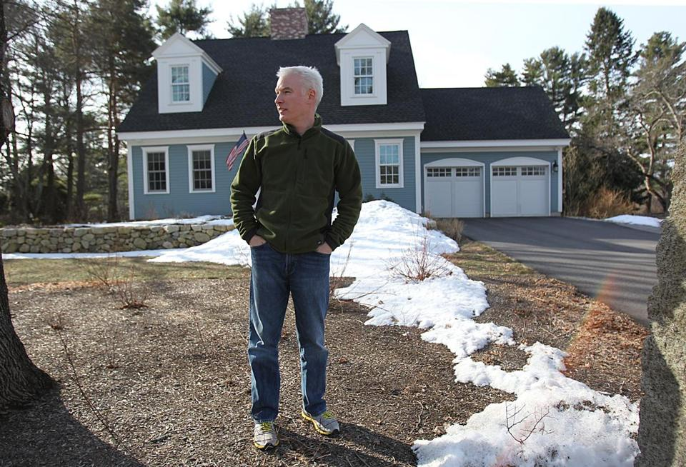 Brian Foulds stands outside his family's Concord home, equipped with many energy-efficient features that will be on display April 6.