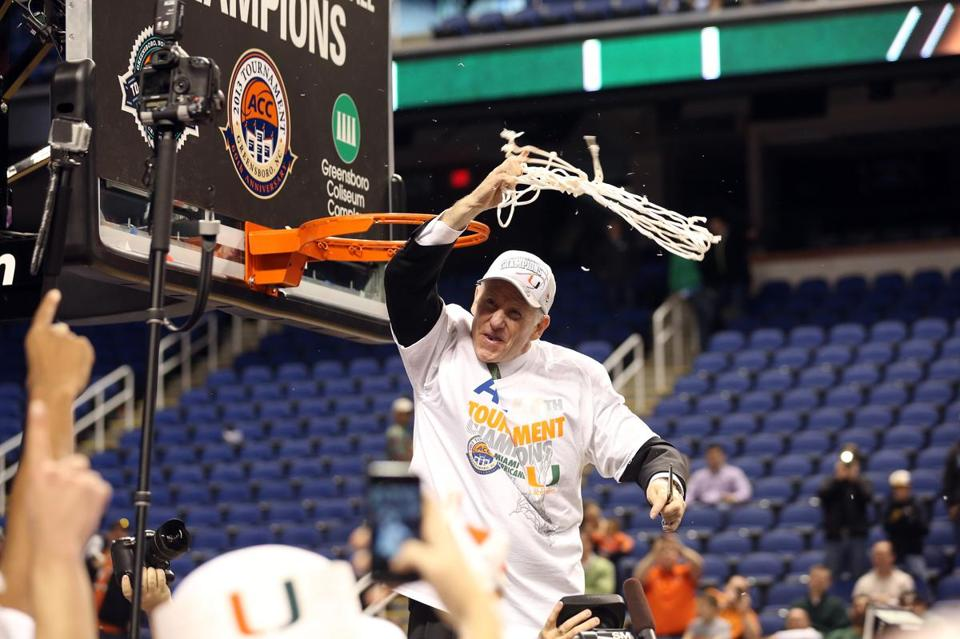 Coach Jim Larranaga cuts the net after Miami beat North Carolina to add the ACC tournament title to its regular-season championship.