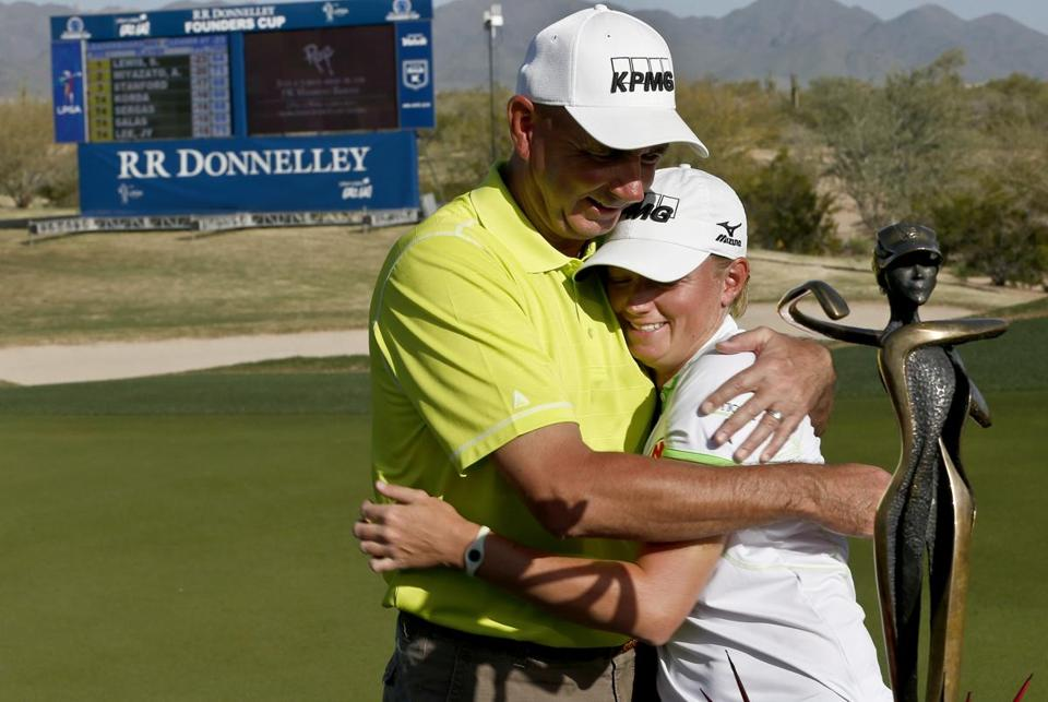 Stacy Lewis hugs her father, Dale, after she won the LPGA Founders Cup tournament and earned the No. 1 spot in the world rankings.