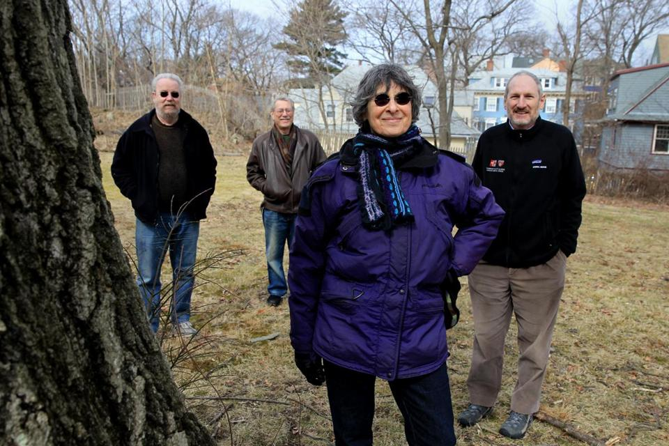 Arthur Johnson (left), Kevin Batt, Barbara Kaplan, and David Bor pooled their resources to buy a vacant lot in their Jamaica Plain neighborhood and are planning to build new housing on the site.