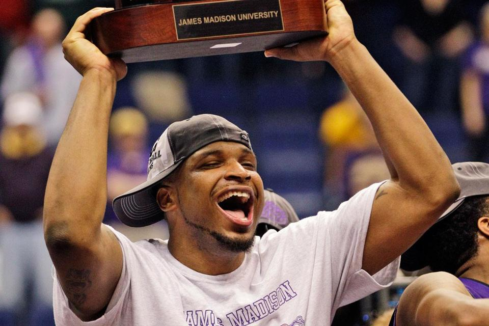 James Madison's Rayshawn Goins was all smiles after beating Northeastern for the CAA title, but will have to sit out the first half of Wednesday's NCAA firstround game.