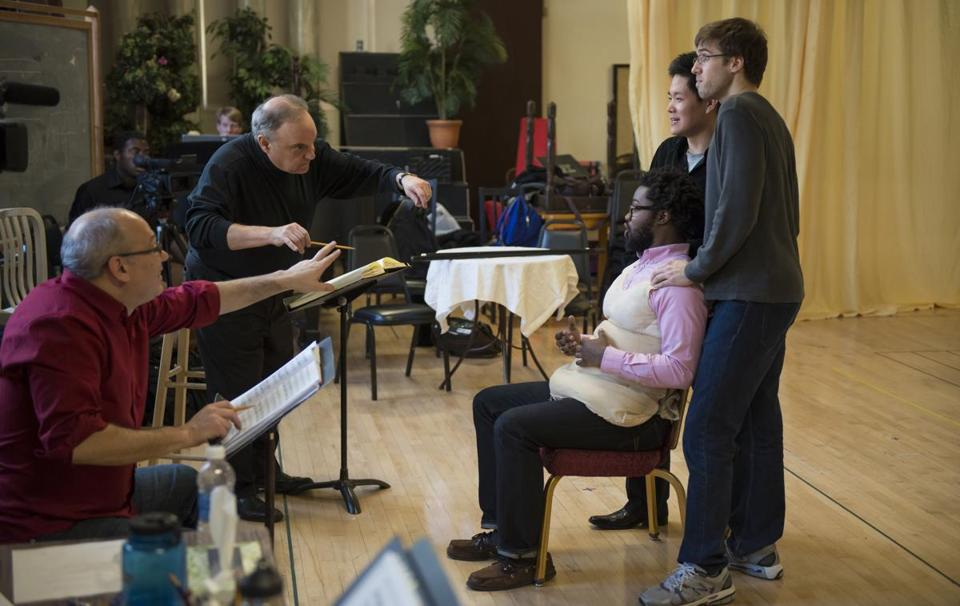 "From left Stage director Joshua Major, conductor Joseph Rescigno, and NEC students Leroy Davis, David Daehan Lee, and Jimmy Dornier rehearsing Rossini's ""La Gazzetta"" at New England Conservatory."