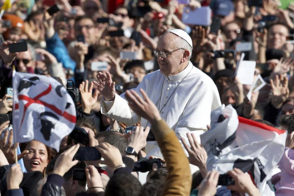 Pope Francis shook hands and mingled with the masses at the Vatican gate after his first Mass as pontiff.