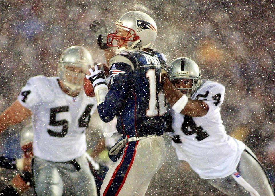 Charles Woodson's hit on Tom Brady in this 2002 playoff game prompted the use of the tuck rule that helped the Patriots propel their run to the Super Bowl.