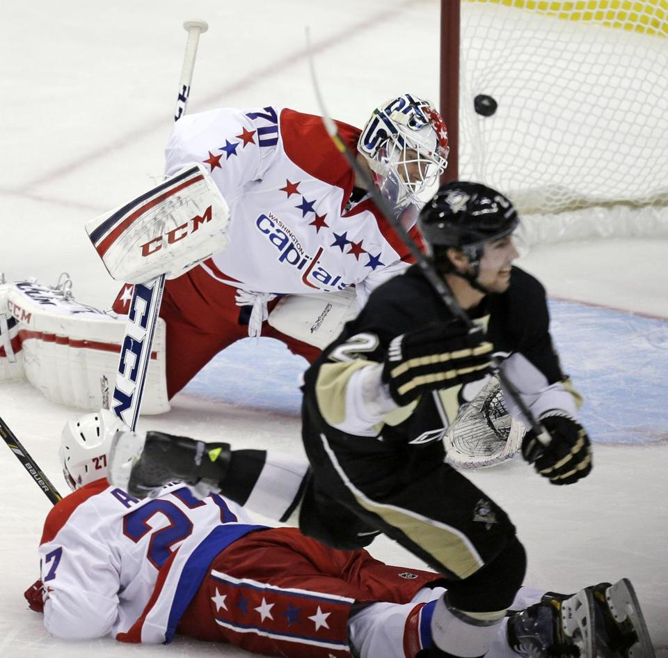 Penguin Matt Niskanen knocked the go-ahead strike past goalie Braden Holtby (70).