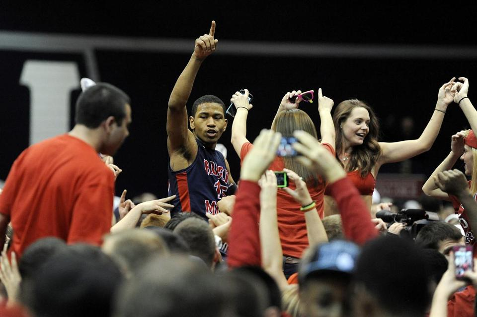 Robert Morris guard Karvel Anderson (center) celebrates with the home crowd after knocking off defending national champ Kentucky.