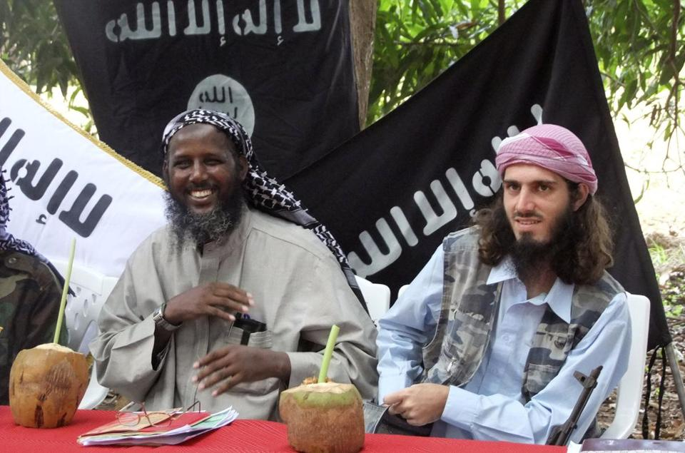 Omar Hammami (right) stars in several videos on YouTube. He once fought with the Somali militant group Al Shabab.