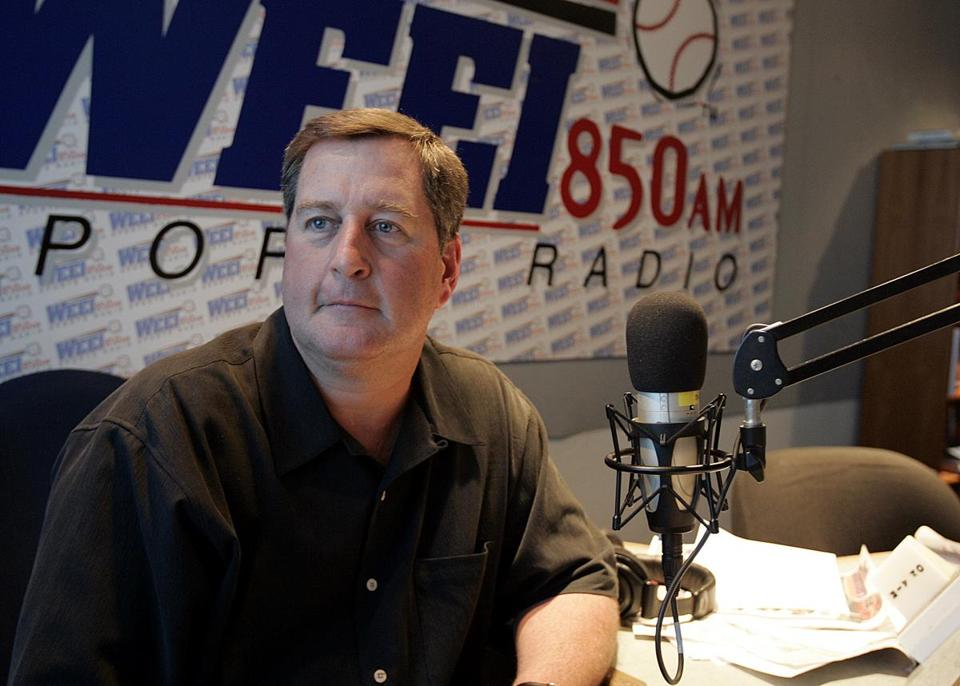 "John Dennis suggested during Thursday's ""Dennis and Callahan'' program that Kirk Minihane was relegated to the Kevin Winter Memorial Sports Flash booth because NESN had cut back on a camera during its simulcast."
