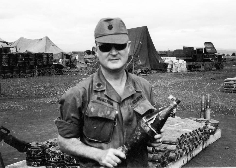 Thomas P. McKenna holding a rocket-propelled grenade warhead captured in 1971 in Vietnam.