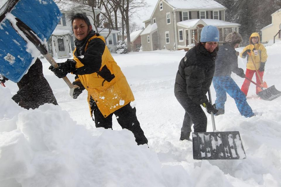 Neighbors and friends in Lexington worked together to clear each other's driveways on Feb. 8.