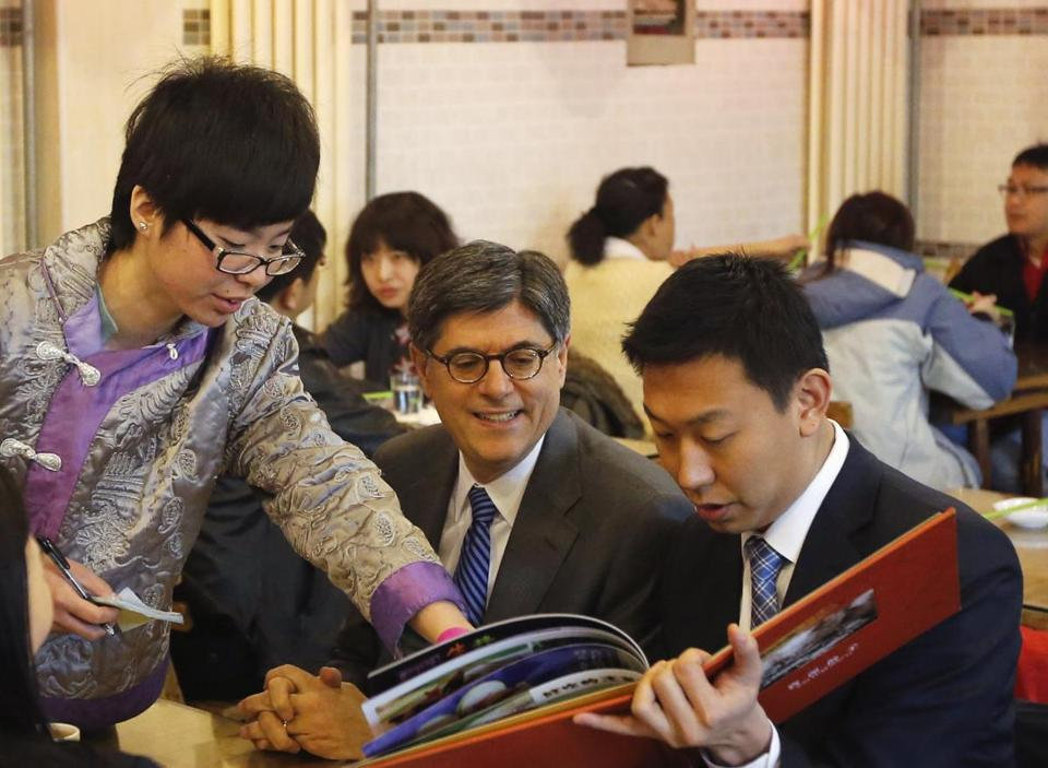 US Treasury Secretary Jack Lew, center, looks over the menu with US government officials at a dumpling restaurant in Beijing Tuesday.