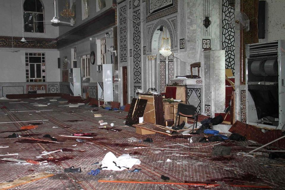 Syrian-run media broadcast images of the destruction in the Damascus mosque.