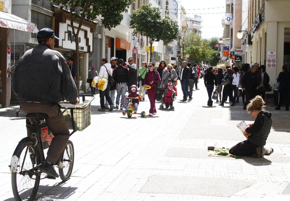 Residents of Nicosia, Cyprus, were in a downtown shopping district Saturday.