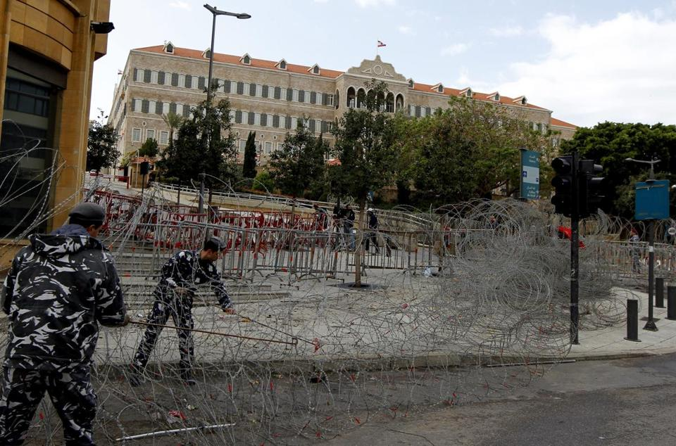 Security removed barded wire around the government palace in Beirut after protesters ended a sit-in.