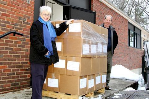 Carol Stollar, Stuart Perlmutter, and other members of the Religious Services Committee at Temple Reyim in Auburndale recently shipped 48 boxes of gently used High Holy Day prayer books to Congregation Abayudaya in Mbale, Uganda.