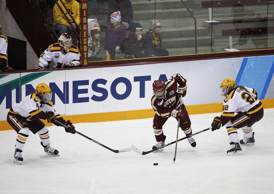 BC forward Dana Trivigno (center) was surrounded as the Eagles took No. 1 Minnesota to OT in the women's semifinals.