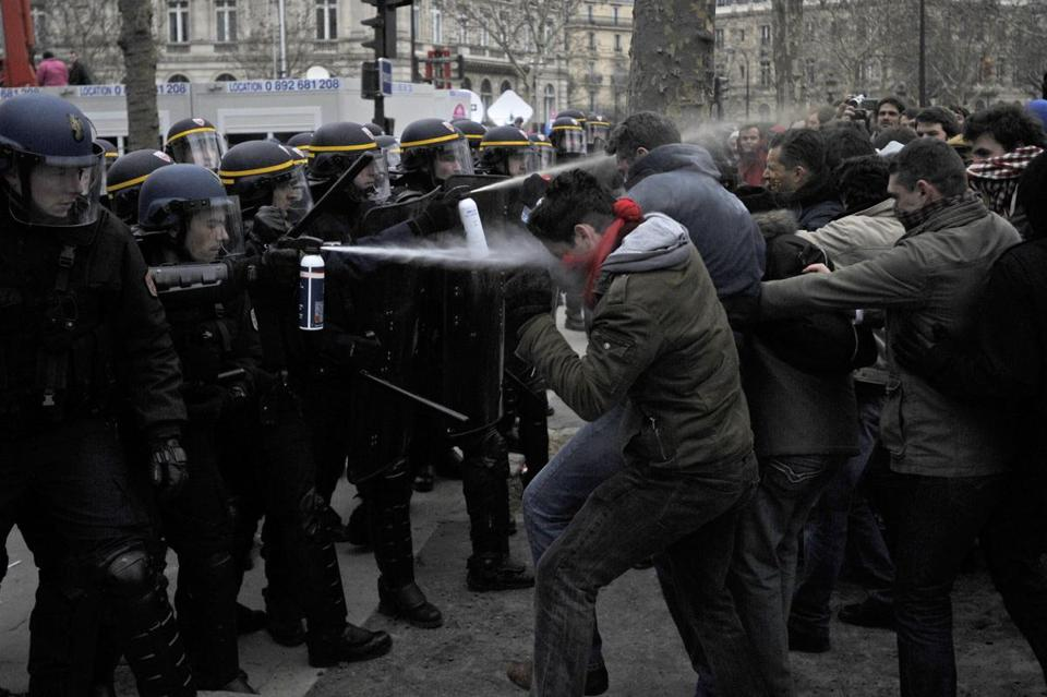 Riot police fired tear gas to try to stop protesters from advancing onto Avenue des Champs-Elysees in Paris during clashes over France's push to legalize same-sex marriage.