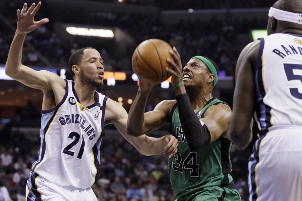 The Celtics' Paul Pierce drives to the basket between the Grizzlies' Tayshaun Prince and Zach Randolph.