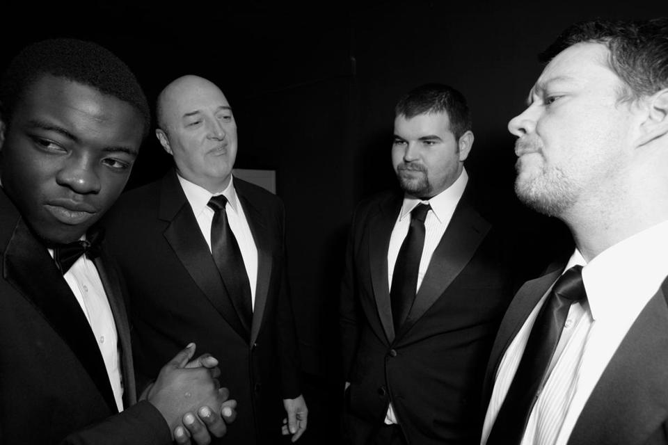 "From left: Seyi Ayorinde, Joe Siriani, Patrick Curran, and James Bocock play bouncers, rough-edged lads, and gals on the make in John Godber's 1977 play ""Bouncers."""