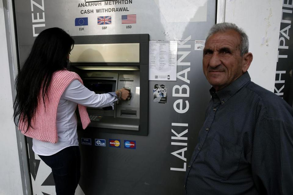 ATMs in Cyprus have been functioning, even with banks closed, but users face limits.