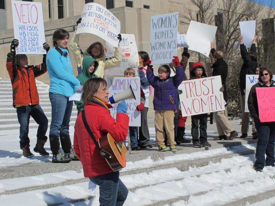 Kris Kitko lead chants of protest at an abortion-rights rally at the state Capitol in Bismarck, N.D., on Monday, March 25, 2013.