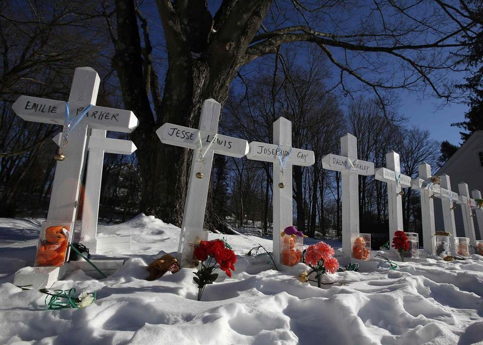 Crosses dominated a roadside memorial on the day the Sandy Hook, Conn., schoolchildren began classes in a neighboring town following the shooting in their hometown school.