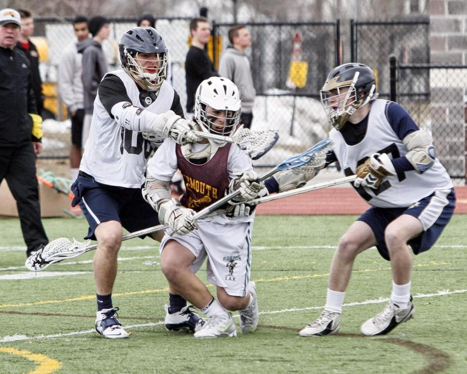 Above, Archbishop Williams defenders sandwich the Weymouth attackman during the scrimmage against Weymouth High School in Weymouth on Monday. At left, Archies attackmen Nick Menzel (left) and Max McClay before the scrimmage.
