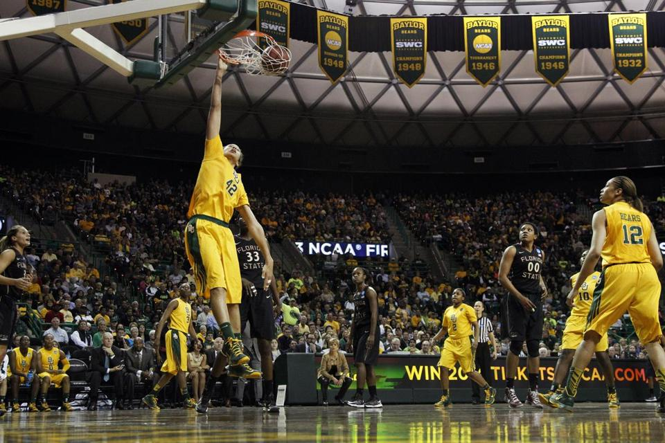 Baylor's Brittney Griner had three dunks — the best this one-handed flush — and scored 33 points in her final home game.