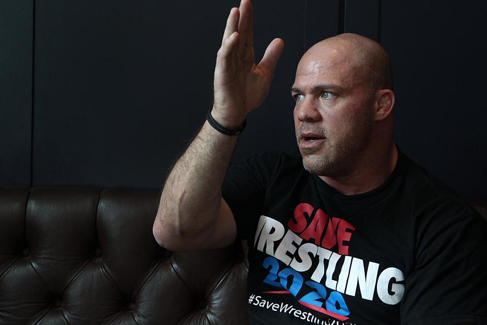 Kurt Angle, now a professional wrestler, would like to see the Olympic sport simplified and spiced up a little.