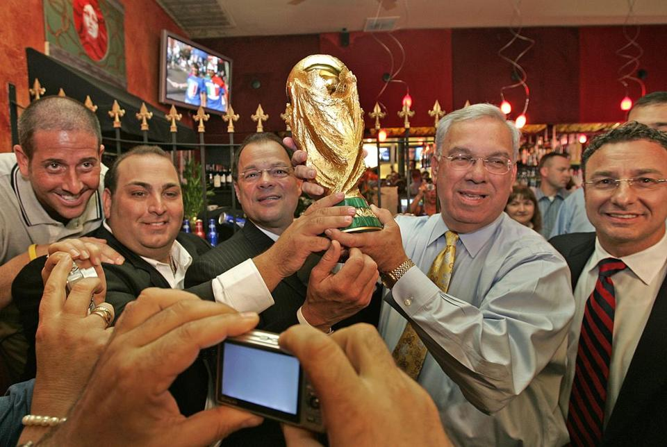 Senate President Robert E. Travaglini, third from left, with Mayor Thomas Menino and the soccer World Cup, Oct. 4, 2006. with them are Nick Gregory of Budwiser, Strega Restaurant owner Nick Varano, and Boston City Councilor Sal LaMattina.