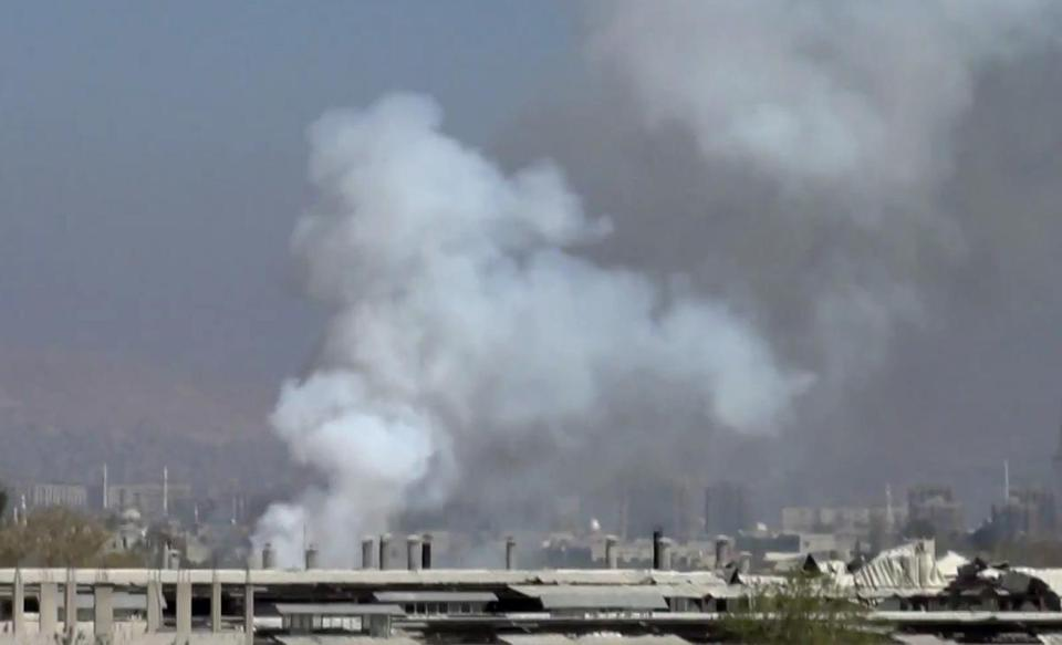 Smoke rose from buildings allegedly shelled in Damascus on Thursday.