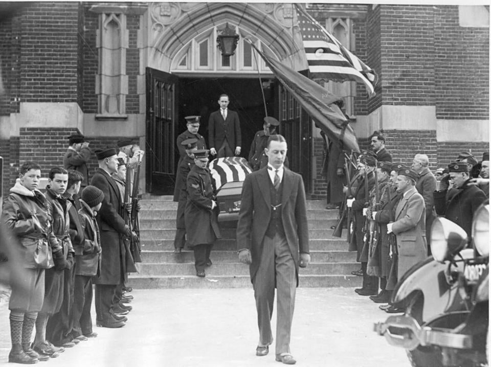 A police honor guard carried Officer Forbes McLeod's casket after a service at St Joseph's Church in Needham in February 1934.