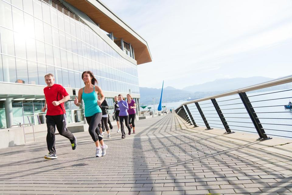 Ian Pullan, left, general manager of the Fairmont Waterfront in Vancouver, British Columbia, is also a marathoner and twice a week, rain or shine, takes guests on scheduled runs along the seawall.