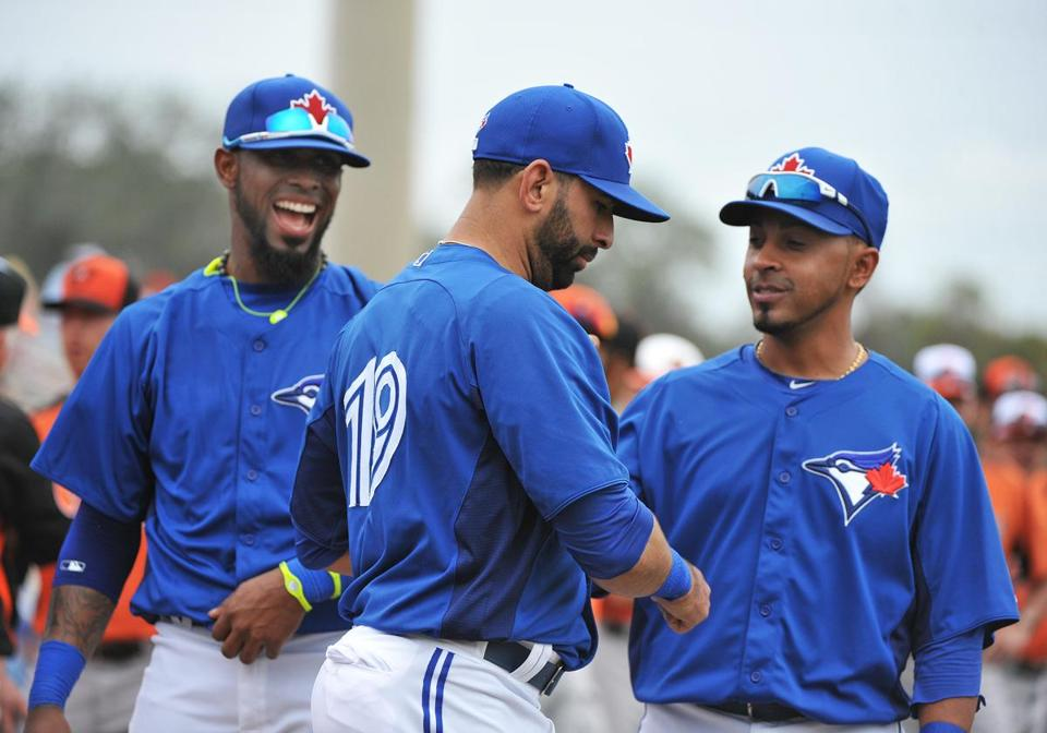 Jose Reyes , left, and Maicer Izturis, right, will help Jose Bautista try to take the Blue Jays back to the playoffs this year.