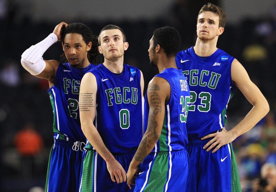 (From left) Sherwood Brown, Brett Comer, Dajuan Graf, and Eddie Murray were left to wonder what happened after the 15th-seeded Eagles' magical run came to an end.