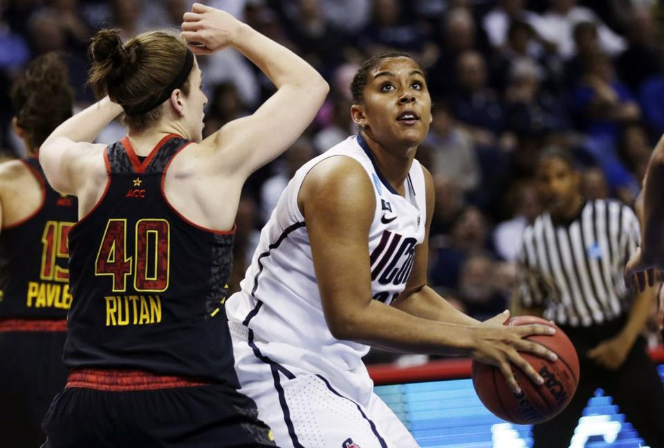 UConn sophomore Kaleena Mosqueda-Lewis (17 points) keeps her eyes on the basket despite the defense of Maryland's Katie Rutan.