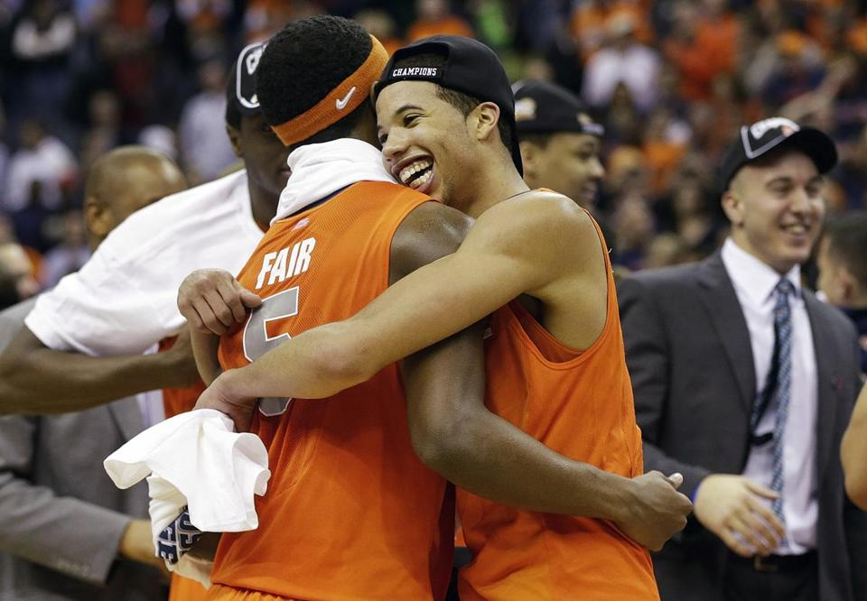 Syracuse teammates C.J. Fair and Michael Carter-Williams celebrate the school's fifth trip to the Final Four.