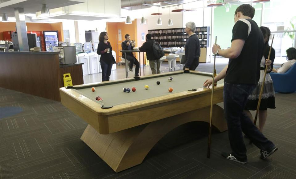 Pool tables and massage chairs are made available to Google employees in Mountain View, Calif.