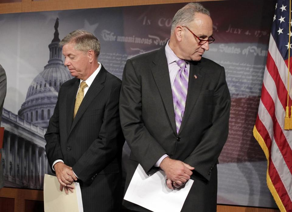 Senator Lindsey Graham and Senator Charles Schumer have been working on immigration reform, which includes lifting the cap on H-1B visas. AP file photo/J. Scott Applewhite.